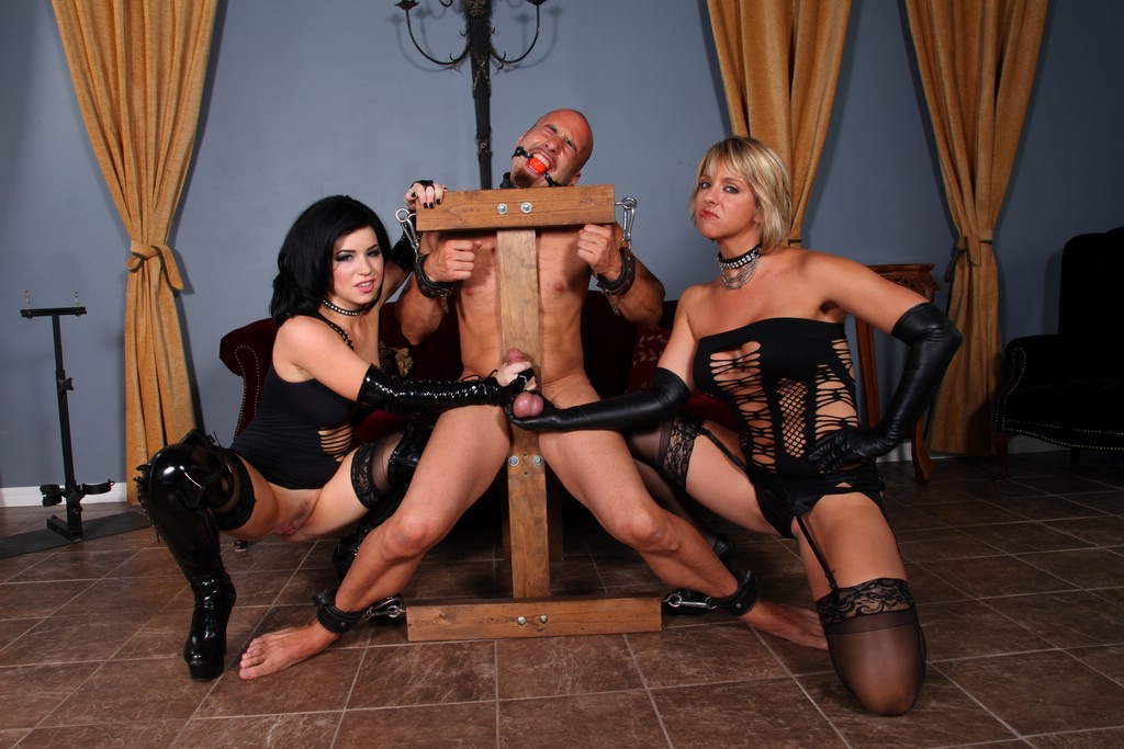 Two mistress squeezes his balls